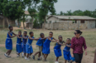 School of Management undergraduate Hira Kashif leads a group of children at the Bawaleshie School in Ghana. Photo: Anthony Falvo