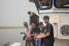 From left, Prince Oduro, executive director of African Rights Initiative International; Evelyn Quist, UB MD/MBA student; Joshua Holmes, a Rochester Institute of Technology student; and UB pharmacy student Ebne Rafi travel by boat to the Afram Plains region in Ghana. Photo: Jordi Owusu