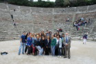 Students and faculty in ancient Greek stadium