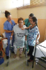 Patient with walker and nurses