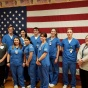 Nursing students and faculty with American flag.