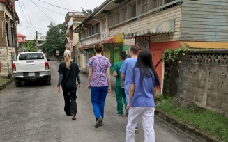 nursing students walking through town in Belize.