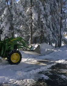 tractor plowing snow.