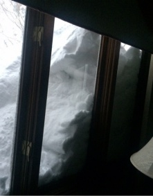 snow piled against a window.