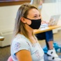 Nursing student wearing mask in class.
