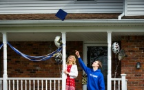 graduate with mom on porch.