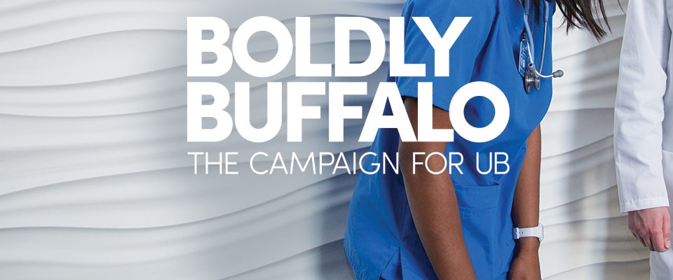 "nurse in scrubs and nurse with white coat with words ""boldly buffalo""."