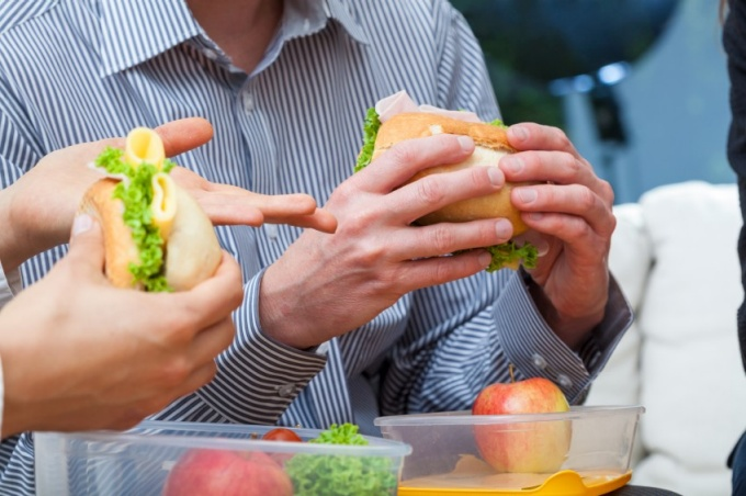 People eating sandwiches.